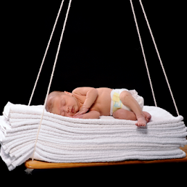 It's all about comfort by Vineet Johri - Babies & Children Babies ( vkumar, new born, sleeping, baby, swing, cute, towels, comfortable )
