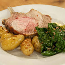 Berkshire Pork Chops with Pan-Fried Fingerling Potatoes and Wilted Kale