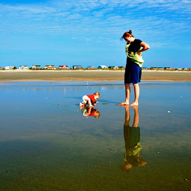 A mother and her son play on the beach by Tyrell Heaton - People Family ( water, mother, son, beach, baby )