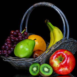 A basket of fruits. by Dipali S - Food & Drink Fruits & Vegetables ( orange, green, delicious, banana, nutrition, antioxidants, red, grapes, kiwi, food, basket, vegetable, natural, pear )