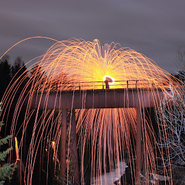Sparking the Rail by Jamie Rabold - Abstract Fire & Fireworks ( canon, train trestle, steel wool, j rabold, spinning fire, north shore, lake superior, sparks, spring, spinning wool )