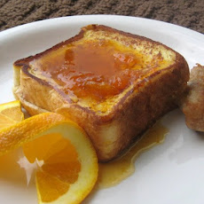Pecan Cream Cheese Stuffed French Toast with Almond Citrus Syrup
