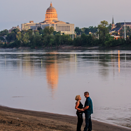 Missouri River Couple by Kevin Anderson - People Couples ( building, missouri, riverside, romantic, reflections, couple, sandy, jefferson city, capitol, romance, river )