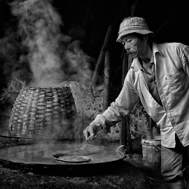 Traditional Brown Sugar Maker by Hendy Kayana - People Portraits of Men ( market, black and white, human interest, cooking, traditional, people, man, sugar )