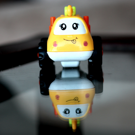 Same to Same by Deepak Sharma - Artistic Objects Toys ( car, face, toy, baby, smile, eyes, refelection,  )