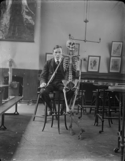 Young man with skeleton, possibly JJ Clarke himself