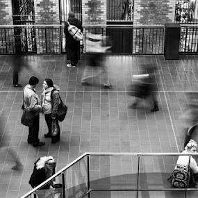 Moment in time by Howard Ferrier - Black & White Street & Candid ( melbourne central, walking, monochrome, discussion, rush hour, melbourne, black & white, blur, workers, commuters, movement, conversation, couple, motion,  )