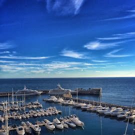 by Jose Figueiredo - Landscapes Travel ( blue sky, boats, harbour )