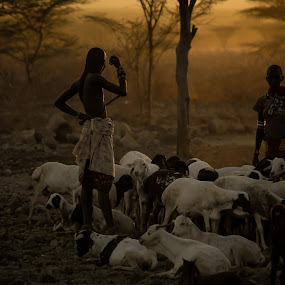 African family by Dragos Birtoiu - People Family ( warrior, animals, african, sunset, poor, sheep, survival )