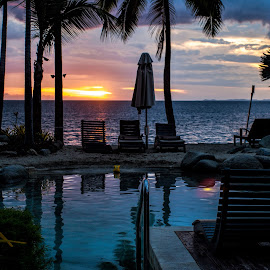 sunset by the pool by Vibeke Friis - Landscapes Sunsets & Sunrises ( pool, pool furniture, sunset, palms,  )