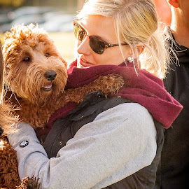 Blonde Woman Holding Cute Brown Dog by Dave Sheffield - People Street & Candids ( taming of the slough 2014, smiling white woman with brown dog at sunrise, smiling puppy and blonde woman, happy morning with a puppy, blonde woman and dog )