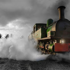 This is a shot at dusk of the the Slieve Callan, one of the only running steam engines of its kind in Ireland and restored to its former glory by local Co. Clare, businessman, Jackie Whelan by Edward White - Transportation Trains