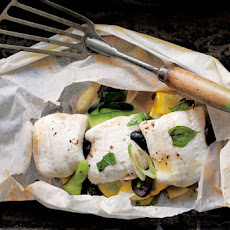 Fish in Parchment with Zucchini, Black Olives and Basil Recipe