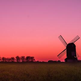 Sunset behind windmill by Syed Hashmi - Landscapes Sunsets & Sunrises