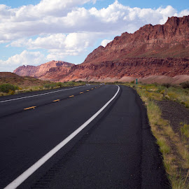 Empty road leading off into the beautiful, red mountains of Flam by Stretch Clendennen - Landscapes Mountains & Hills ( landmark, mountain, red, highway, utah, empty, scenic, road, travel, landscape, lonely, flaming gorge )