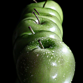 Apples in a row. by Dipali S - Food & Drink Fruits & Vegetables ( diet, drop, breakfast, leaf, life, fresh, juice, lifestyle, water, isolated, fruit, waterdrop, green, white, delicious, red, food, apple, background, ripe, summer, healthy, freshness, eat, vitamin, garden, natural )