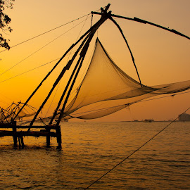 Waiting for the fish by Mike O'Connor - Artistic Objects Industrial Objects ( water, sunset, fish, fisherman, net )