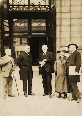 Paul Otlet (centre) and Henri La Fontaine (right) outside   the entrance of the Palais mondial at the Palais du   Cinquantenaire