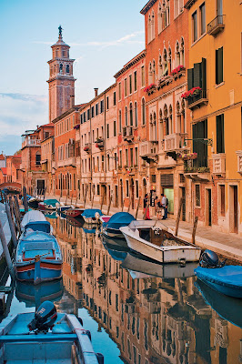 A painterly scene of Venice at dusk. The City of Canals is one of the destinations on a Tere Moana cruise.