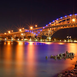 evening glow by Helen Bagley - Buildings & Architecture Bridges & Suspended Structures ( orange, night photography, night lights, night scene, long exposure, bridge, rivers, nightscape, creativity, lighting, art, artistic, purple, mood factory, lights, color, fun,  )
