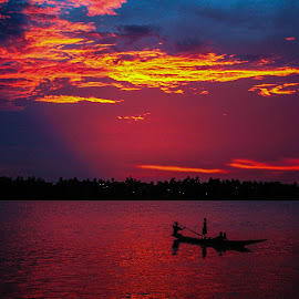 Last light... by Mahul Mukherjee - Landscapes Sunsets & Sunrises ( colour, clouds, sky, boat, dusk, people, river )