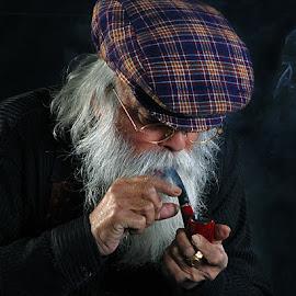 Lighting his pipe by Rakesh Syal - People Portraits of Men (  )