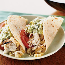 Fish Tacos with Creamy Lime Guacamole and Cabbage Slaw
