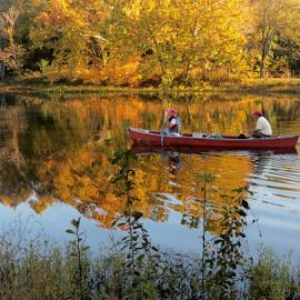 Autumn canoe ride by Nancy Tharp - Transportation Boats