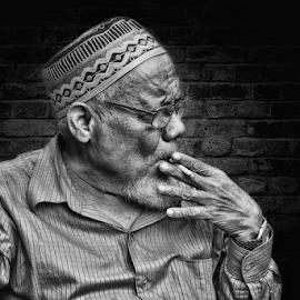 Old Man by Haryo Suryo - Black & White Portraits & People ( old, smoking, mature, enjoy, man )