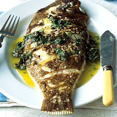 Whole BBQ flat fish with a mint and parsley dressing