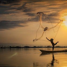 Shilouette of Fisherman by Indrawan Ekomurtomo - People Professional People (  )