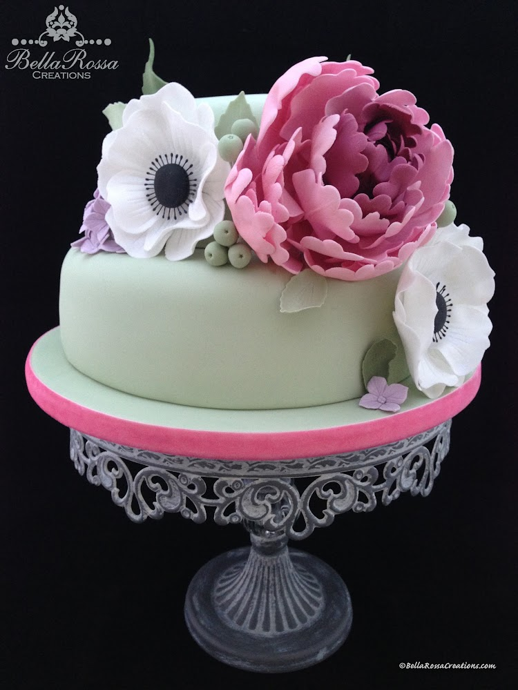 Lemon sponge cake with caramel ganache covered with spruce green fondant. The cake was decorated with a handcrafted peony, some poppies and hydrangea flowers made from gum paste. Perfect cake for any special celebration!