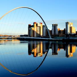 reflections of a bridge by Paul Pirie - Buildings & Architecture Bridges & Suspended Structures ( water, arch, buildings, reflections, bridge, river )