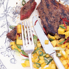 Honey and soy glazed BBQ steaks with mango salsa