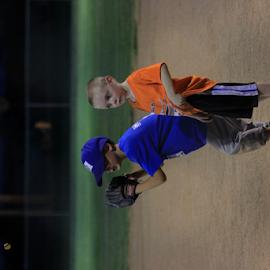 Kansas T-Ball by Robert D Brozek - Sports & Fitness Baseball ( fence, orange, blue, baseball, green, youth, tball, boy's, kansas, hat,  )