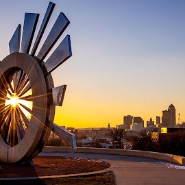 Shattering Silence sculpture at sunset by Justin Rogers - City,  Street & Park  Skylines ( skyline, cityscape, sunlight, city park, sun rays, city, sunburst, sculpture, skyscraper, sunset, sunrays, sun light, monument )