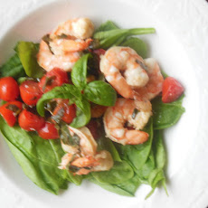 Basil Shrimp and Tomatoes Over Spinach