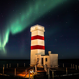 Garður lighthouse, Iceland. by Hafsteinn Kröyer Eiðsson - Buildings & Architecture Public & Historical ( suðurnes, old, bright, door, house, architecture, keflavik, night shots, eos, sky, night photography, reykjanes, skyview, light, night sky, skyscape, garður, platform, white, windows, stripes, old building, astrophoto, fence, iceland, night photo, stars, public place, fast, star view, night shot, nightscapes, canon, night lights, aurora borealis, ocean, nightview, canon eos, 18mm, stairs, nighttime, astrophotography, ocean view, canon eos 650d, starscape, tamron 18-200mm, nightlife, building, purple, aurra, night scene, green, lighthouse, star, night time, nightscape, red, night view, oceanscape, reykjanes peninsula, nightography, night, historical, public )