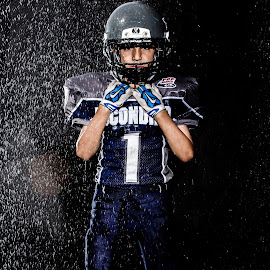 by Michael Cazares - Sports & Fitness American and Canadian football ( pop warner, football, tackle )