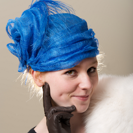 Cheeky redhead in hat with leather glove by Nick Dale - People Fashion ( cheeky, girl, blue, woman, fur, redhead, leather, portrait, mesh, hat )