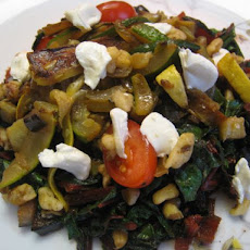 Warm Swiss Chard Salad in Brown Butter with Sauteed Vegetables, Goat Cheese, and Walnuts