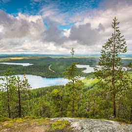 Konttainen Hill, Ruka by Xavier Barceló Pinya - Landscapes Mountains & Hills ( clouds, blue sky, trees, finland, lake )