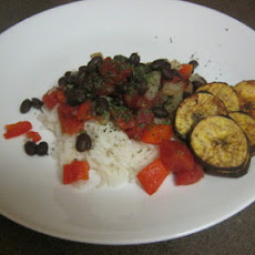 No Fail Black Beans and Rice Garnished With Crispy baked Plantain Chips