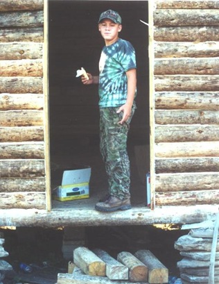 Building the cabin - Tyler in door