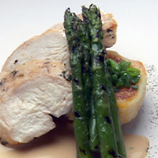 Breast of Chicken on Pumpkin/Cranberry Rissole with White Chocolate Balsamic Sauce and Asparagus