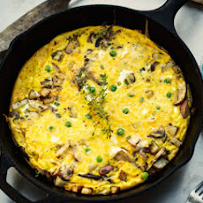Wild Mushroom Frittata with Cheddar, Green Onions, and Peas