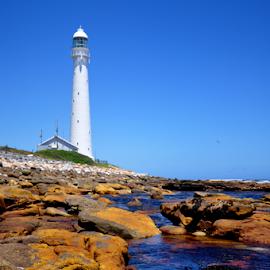 Lighthouse by Lennon Fletcher - Landscapes Beaches ( rocks water and sky, blue sky, lighthouse, seaside, light, rocks )