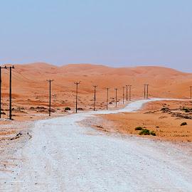 Civilisation ahead! by Uroš Petrič - Landscapes Deserts ( emirates, united, sky, dry, desert, nature, arab, uae, path, hot, road, gravel, landscape )