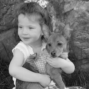 Little Girl and Her Puppy by Scott Morgan - Babies & Children Children Candids ( little girl, b&w, black and white, pet, dog, kid,  )
