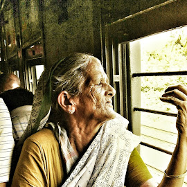 aging gracefully by Saikat Kundu - Instagram & Mobile Android ( wrinkles, moving, window, old lady, ear ring, green, white, public transport, train, candid, travel, saikat kundu,  )